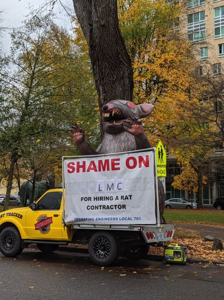 PMG JOSEPH GALLIVAN - Portland's Operating Engineers Local 701s Rat Tracker — a giant inflatable rat on the back of a truck - is used to call out non-union subcontractors at job sites. Here  at the Park blocks in November, 701 went after Lennar for using the excavator Konell.