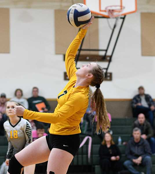 PMG PHOTO: CHRISTOPHER OERTELL - Gaston's Hannah Farmer goes up for a ball during a match this past season. Farmer was one of two Greyhounds selected third team All-Northwest League.