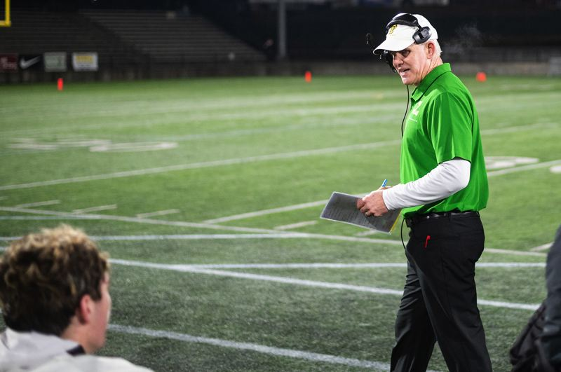 PMG PHOTO: CHRISTOPHER OERTELL - West Linn head football coach Chris Miller directs his team during his final game — a 42-35 loss to Central Catholic in the Class 6A state quarterfinals on Friday, Nov. 22, at Hillsboro Stadium.