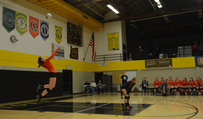 PMG PHOTO: STEVE BRANDON - Senior Darci DeTroy of Scappoose High delivers a jump serve during a Northwest Oregon Conference match.
