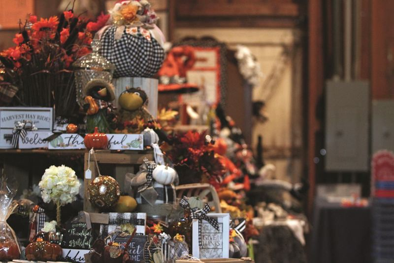 PMG PHOTO: PHIL HAWKINS - Though the bazaar is comprised primary of Christmas-themed items, there are plenty of fall and Halloween-centric gifts that will remain on display throughout the 10-week sale., Woodburn Independent - News Mother Hubbard's Cupboard Bazaar opened in 1989, but its history dates back even further  Family bazaar celebrates 30th anniversary