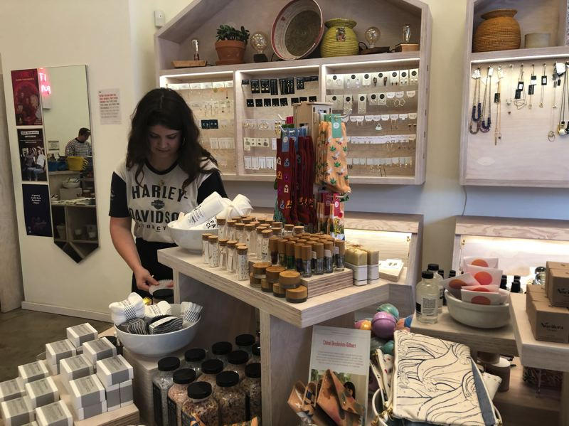 PMG PHOTO: STEPHANIE BASALYGA - Hannah Johnson, an assistant store manager with Tender Loving Empire, readies a display for holiday shoppers at the retailer's flagship store at Southwest 10th Avenue in downtown Portland.