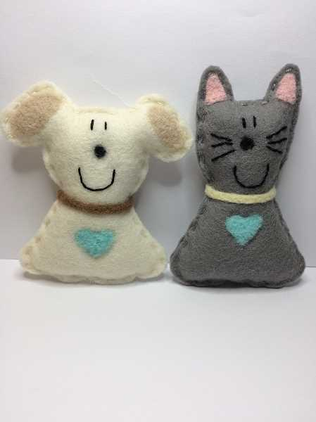 COURTESY PHOTO  - Lake Oswego businesswoman Diane Schweisguth, with collaboration from Bonnie Johnson of Spruce and Steele Designs of Lake Oswego, has launched SmileyHugs dog and cat plushies, intended to bring smiles and comfort wherever and whenever needed.