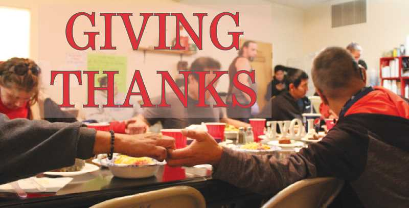DESIREE BERGSTROM/MADRAS PIONEER - Those checked into the Jefferson County Winter Shelter Nov. 22, gather around the table for dinner, and holding hands, recite the Lord's Prayer.
