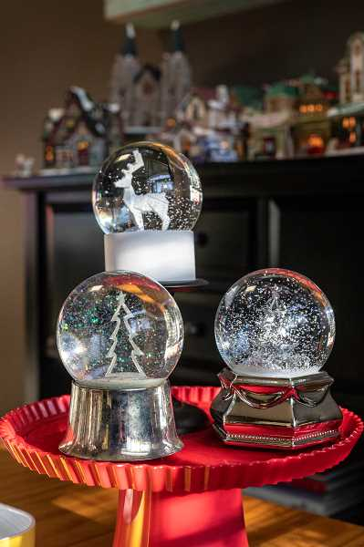 Snowglobes are a delightful accent to the holiday decor at Melissa Hoy's house.