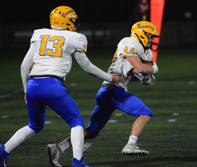 PMG PHOTO: DAVID BALL - Barlow running back NIck Collins (44) has powered the teams physical play during the playoffs, while QB Jaren Hunter (13) has tossed five TDs and ran for three more.