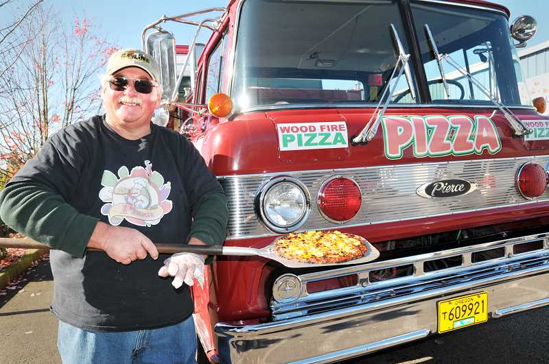 GRAPHIC PHOTO: GARY ALLEN - David Bensch operates Hook n' Ladder Pizza, a food truck selling pies at locations throughout Yamhill County.