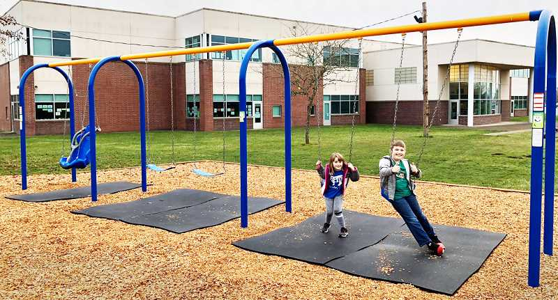 SUBMITTED PHOTO - Kids haven taken to the new swingset installed recently at Antonia Crater Elementary School.