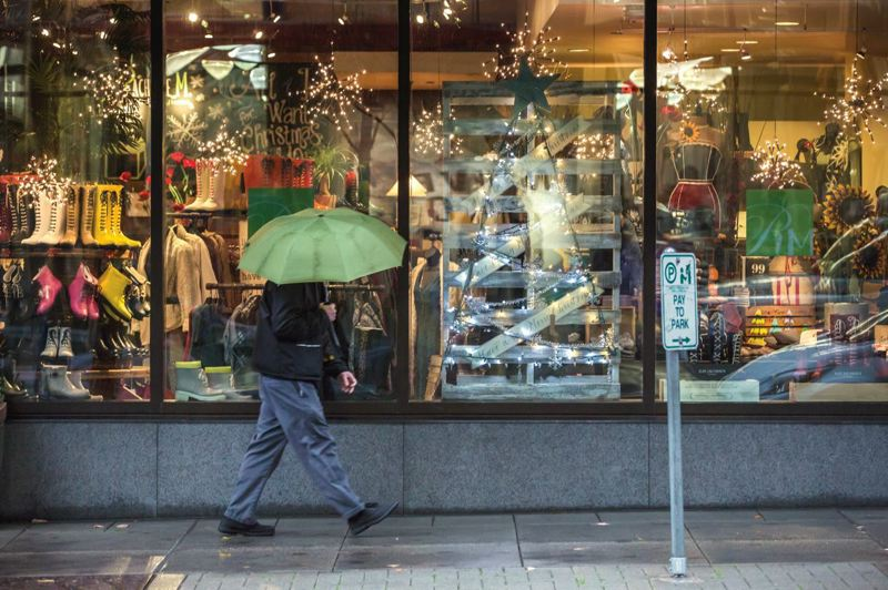 PMG PHOTO: JONATHAN HOUSE - The holiday season heats up in the Pearl District of Portland.