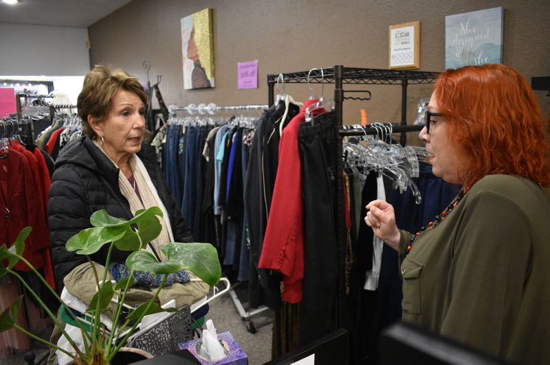 PMG PHOTO: SHANNON O. WELLS - VeeAnn Finnemore, a customer at Shop Girl Consignment, chats about the womens clothing inventory at the 16-month-old shop at 111 N. Main Ave., in downtown Gresham.