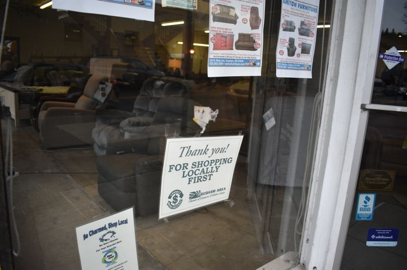 PMG PHOTO: SHANNON O. WELLS - Amiton Furniture, a mainstay of downtown Gresham for decades, proudly displays shop local first promotion signs from the Gresham Area Chamber of Commerce.