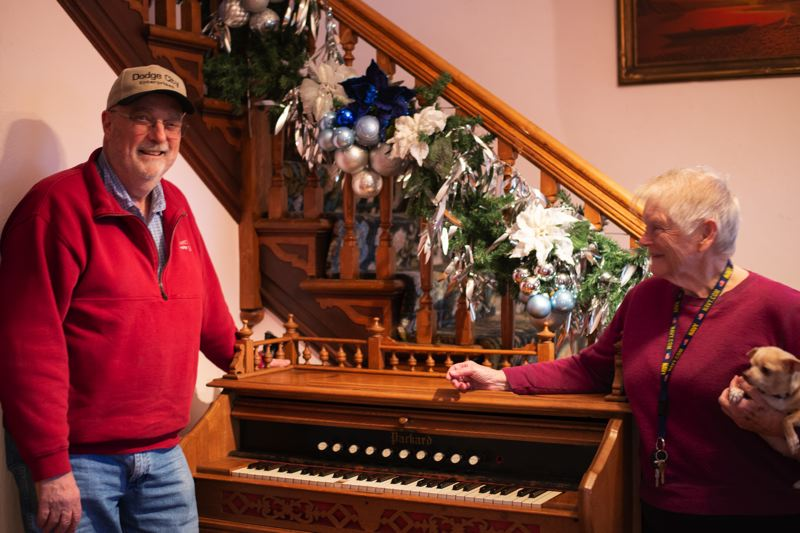 PMG PHOTO: ANNA DEL SAVIO - Torry Johnson, left, donated the pictured organ to the Scappoose Historical Society and Watts House. Johnson delivered the organ to Scappoose Historical Society President Karen Holmberg on Tuesday, Nov. 26.
