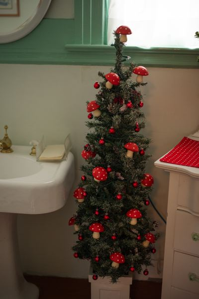 PMG PHOTO: ANNA DEL SAVIO - Decorations at the Watts House arent limited to main rooms. Even bathrooms feature holiday decorations, including a mushroom-adorned tree.