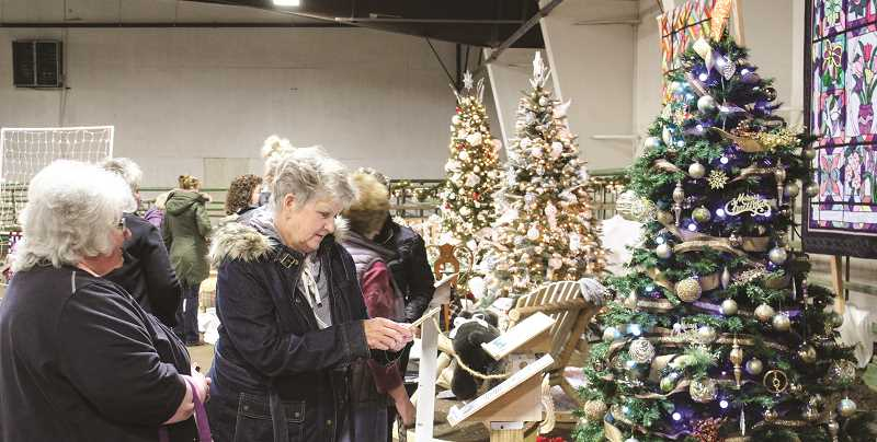 CENTRAL OREGONIAN - The Friday evening open house is a time for the public to stop by the Hospice Christmas Auction site and see the trees free of charge.