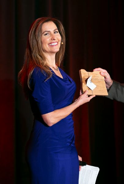 PMG PHOTO: SOOBUM IM - Dawn Grover, attorney for Karsten Manufacturing of Gresham which makes PING golf clubs receiving the Deans Family Business Leadership Award. Her Norwegian grandfather built the company from nothing.