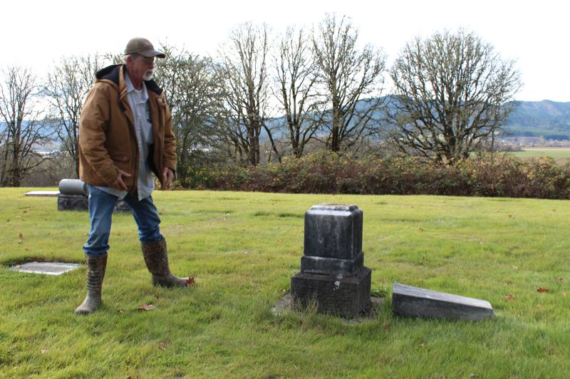 PMG PHOTO: MAX EGENER - Randy Ince, manager of the Forest View Cemetery in Forest Grove, stands next to a gravestone that was vandalized on Sunday, Nov. 24.