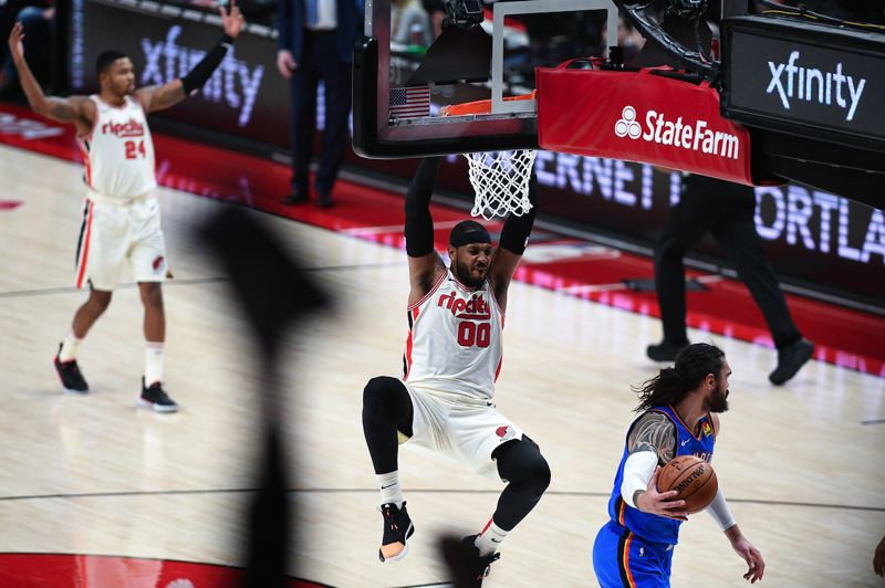 PMG PHOTO: CHRISTOPHER OERTELL - Carmelo Anthony of the Trail Blazers completes a dunk against Oklahoma City on Wednesday night at Moda Center.