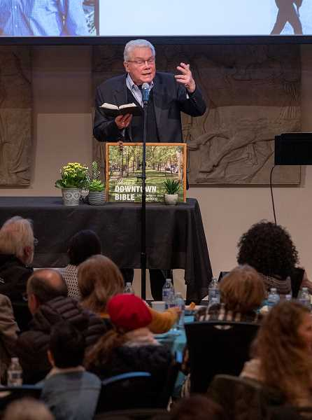 PMG PHOTO: JONATHAN HOUSE - Luis Palau reads from his Bible while addressing a gathering of the Downtown Bible Class held at the Portland Art Museum on Wednesday, where he also celebrated his 85th birthday.