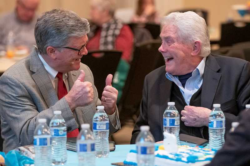 PMG PHOTO: JONATHAN HOUSE - Scott Gilchrist, the senior pastor at Beavertons Southwest Bible Church and coordinator of a Downtown Bible Class held weekly at the Portland Art Museum, shares a light moment with evangelist Luis Palau Wednesday, which was Palaus 85th birthday.