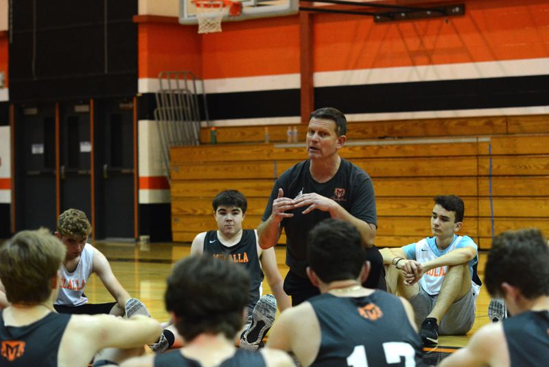 PMG PHOTO: DEREK WILEY - New Molalla boys basketball coach Scott Campbell talks to the team during tryouts.