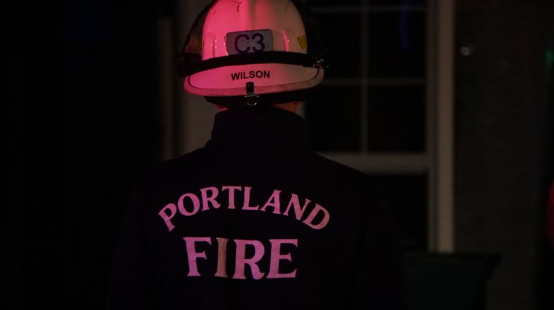 KOIN 6 NEWS - A Portland firefighter at the scene of a fire.