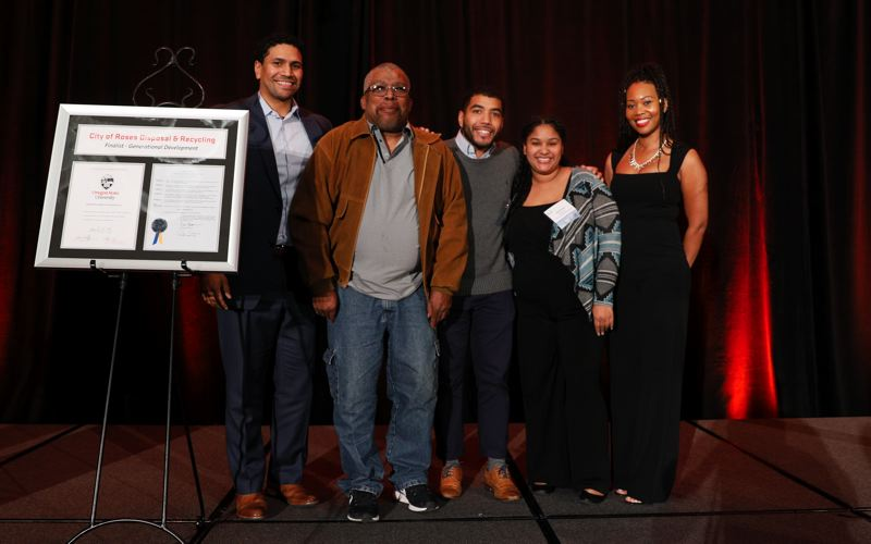 PMG PHOTO: SOOBUM IM - Finalist in the recent Austin Family Business Awards, City of Roses Disposal & Recycling (L-R) vice president Alando Simpson, his father Al Simpson and brother AJ Simpson, his sister Jasmine Ramirez and his wife Morgan Taylor.