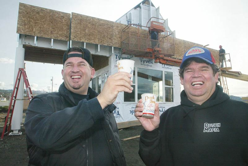 PHOTOS COURTESY: DUTCH BROS COFFEE - Dutch Bros Coffee founders Dane (right) and Travis Boersma around the year 2000. The family coffee stand business from Grants Pass now has 13,000 employees in seven states.