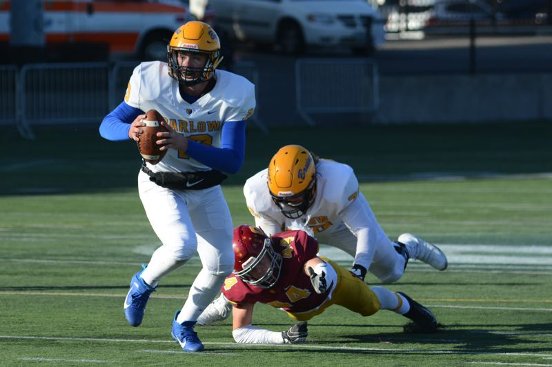 PMG PHOTO: DAVID BALL - Barlow QB Jaren Hunter escapes the pocket.
