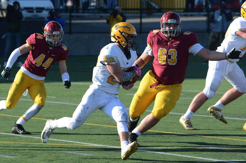 PMG PHOTO: DAVID BALL - Barlows Josh Nomie looks to gain the corner during a carry in the second quarter. He was named Barlow's Outstanding Player for the game.