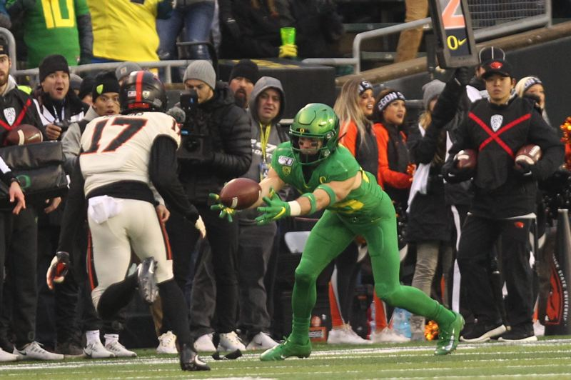 PMG PHOTO: JAIME VALDEZ - Oregon's Brady Breeze recovers an Oregon State fumble in the closing minutes to help the Ducks secure a win in Saturday's Civil War game at Autzen Stadium.