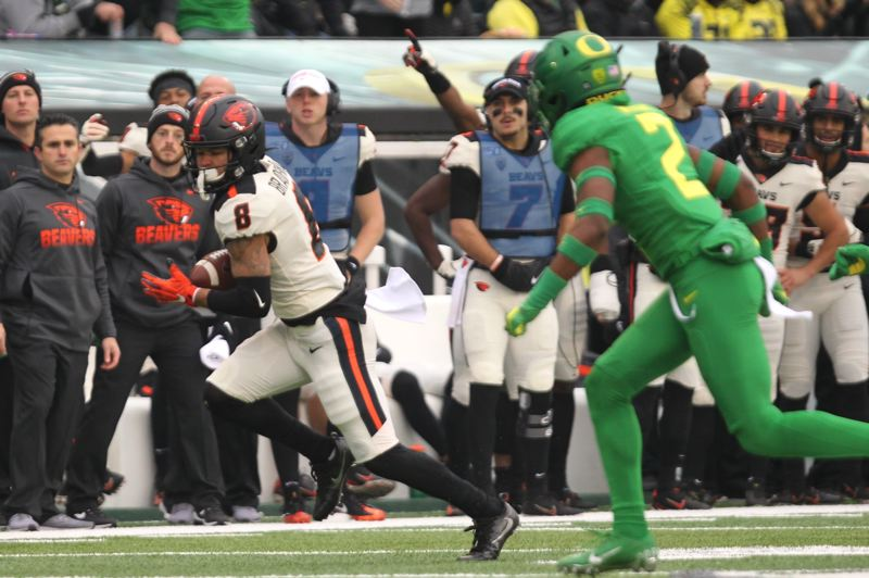 PMG PHOTO: JAIME VALDEZ - Wide receiver Trevon Bradford picks up yardage for Oregon State.