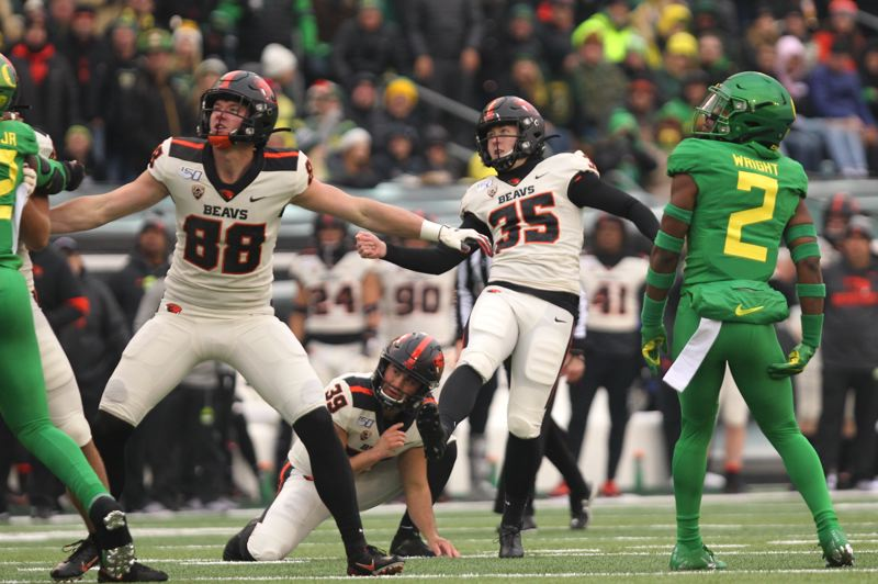 PMG PHOTO: JAIME VALDEZ - Everett Hayes watches as his field goal for Oregon State ties Oregon at 3-3 in the first half.