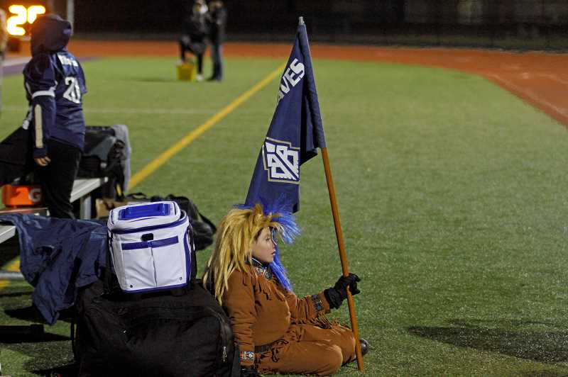 PMG PHOTO: WADE EVANSON - A young Banks fan sits on the sidelines near the end of their state championship game against La Grande Saturday night, Nov. 30, in Hermiston, Oregon.