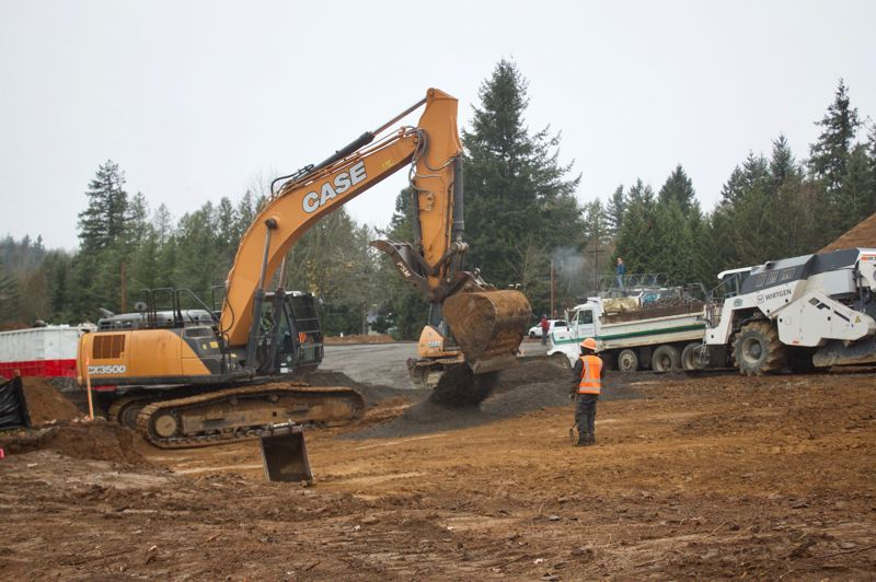 PMG PHOTO: CHRISTOPHER KEIZUR - Grading begins on the future site of three apartment buildings along Powell Boulevard.