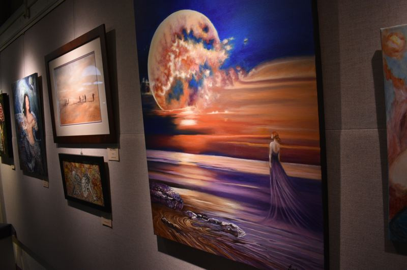 PMG PHOTO: SHANNON O. WELLS - Myth & Magic, the current exhibit at the city of Greshams Visual Arts Gallery on Northwest Eastman Parkway features a wide range of fantastical creations including Jeanie Bates Spellbound (foreground) and Linda Zirkles Mystic Wanderers to its left.