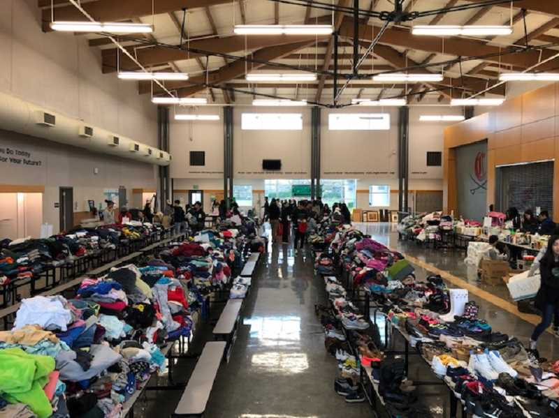 COURTESY PHOTOS - Clackamas High Schools cafeteria tables are covered in donations for families who are in need to pick up.