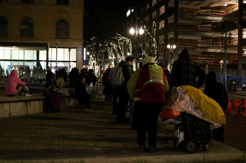 PMG PHOTO: ZANE SPARLING - About 150 to 200 people are served by Free Hot Soup each weeknight, with the line sometimes stretching across three sides of the public square.
