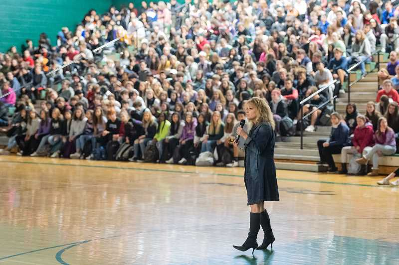 PMG PHOTO: CHRISTOPHER OERTELL - Sparrow Club program coordinator Laura Queen encourages studengs to make a difference by helping others during an assembly at Tigard High School on Nov. 21.