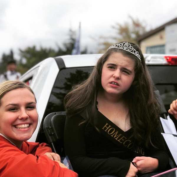 COURTESY OF ANGI SCOTT - Ella, the Sherwood High School Sparrow, participated in a homecoming parade through Sherwood in September. Ella, who loves sports and horseback riding, was diagnosed with a rare genetic disease called Rett Syndrome.