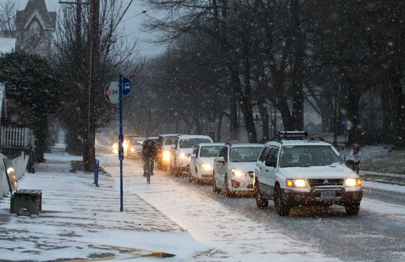 PMG FILE PHOTO - Cars line up on a snowy morning in December 2013 in Portland.