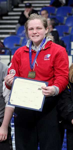 STEELE HAUGEN - Bailey Dennis, a three-time state champion, will look to win her fourth title this season.