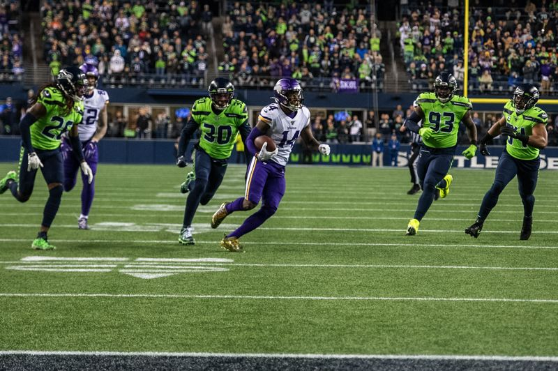 MICHAEL WORKMAN PHOTO - Seattle defenders (from left) Shaquill Griffin, Bradley McDougald, Branden Jackson and Bobby Wagner hunt down Minnesota running back Stefon Diggs.