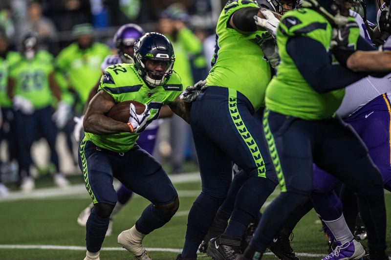 MICHAEL WORKMAN PHOTO - Chris Carson of Seattle looks for running room behind his blockers.