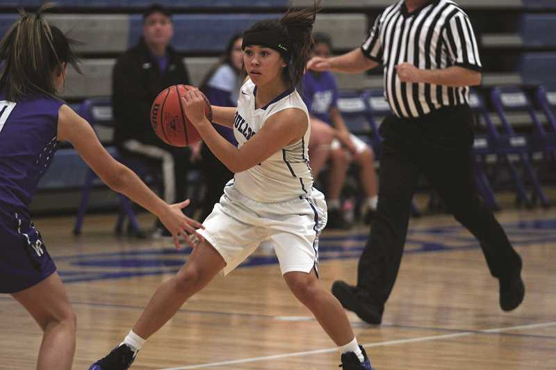 PMG PHOTO: PHIL HAWKINS - Woodburn sophomore Mya Salinas is among the sophomore class of the varsity team that includes teammates Briana Cruz and Aria Kent.