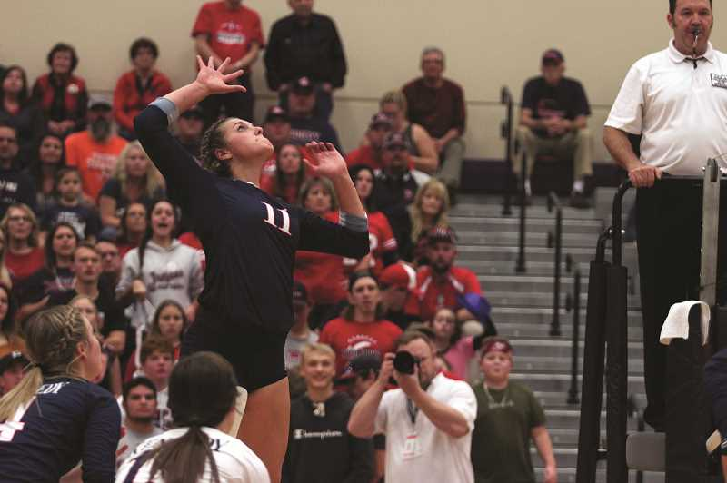 PMG PHOTO: PHIL HAWKINS - Prior to helping the Kennedy Trojans earn their first state championship in program history, senior middle blocker Sophia Carley was named Tri-River Player of the Year.