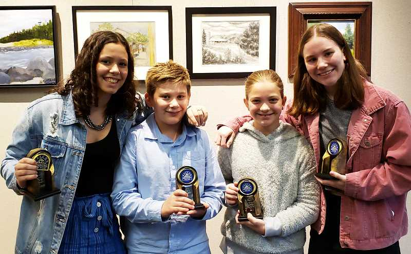COURTESY PHOTO - Canby swimmers Avery Keinonen, Sam Goktas, Quincy Taliaferro and Kali Mull were honored at the Oregon Swimming Top 5 Awards.