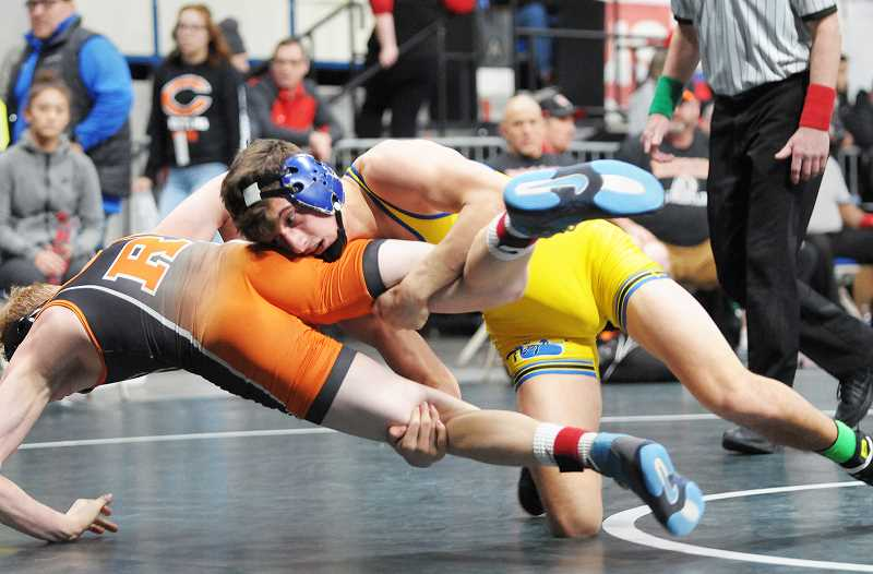 GRAPHIC FILE PHOTO - Newberg junior Charlie Evans finished second in state last year along with his team, with both aiming for redemption this season.