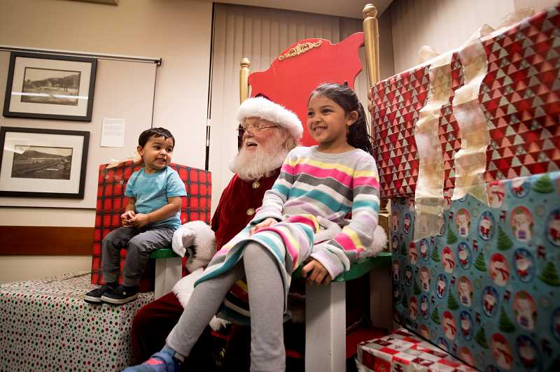 PMG FILE PHOTO - Visiting with Santa in the warmth of City Hall is a perk of the night's event.