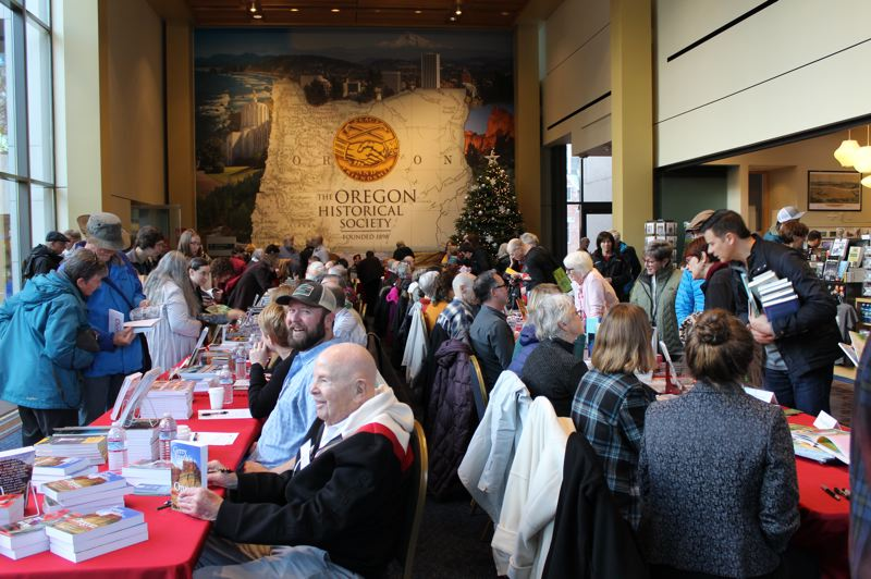 COURTESY PHOTO - Scores of authors and their fans gather for the Holiday Cheer event at Oregon Historical Society, Dec. 8.