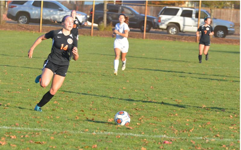 COURTESY PHOTO: JOHN BREWINGTON - Scappoose High senior Emma Jones pursues the ball during the 2019 season, in which the Indians reached the second round of the state playoffs and she earned all-Northwest Oregon Conference first-team honors.